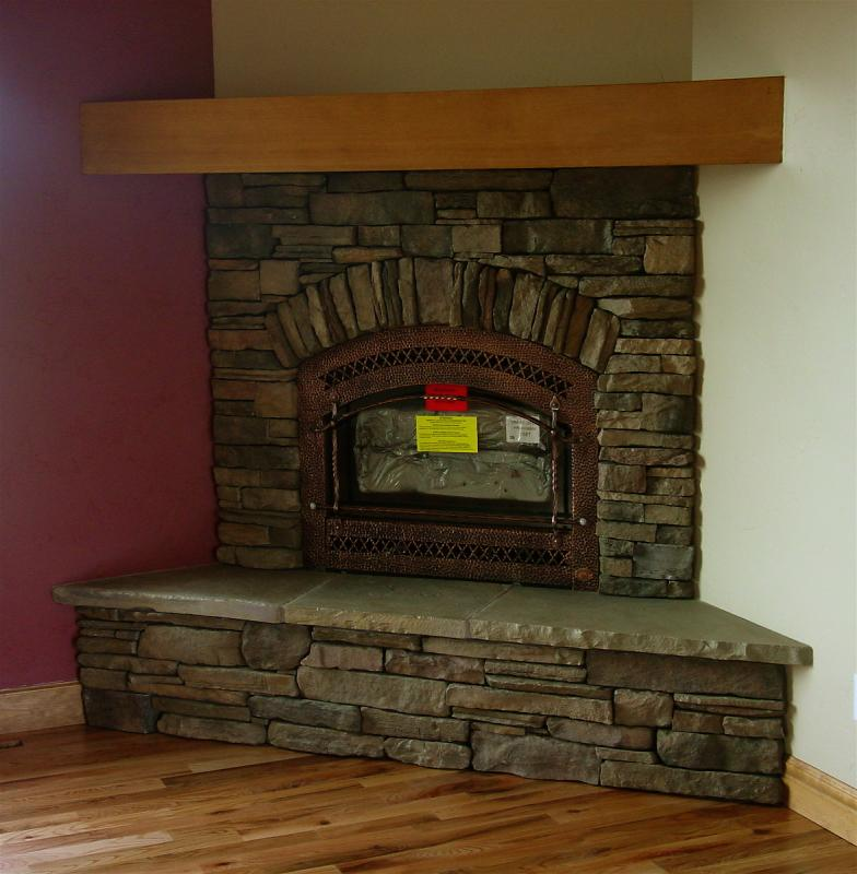 Corner fireplaces fireplaces and fireplace update on for Corner fireplace stone